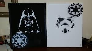 my coworker made this for my daughter to be s star wars themed nursery spray paint on canvas hand cut stencils