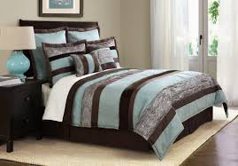 teal and brown bedding with rugs