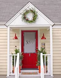 If your front door is red then you might want to get light fixtures and  planters