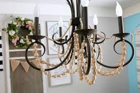 i read several tutorials on how to create a wood beaded chandelier from scratch but ultimately wanted something fast and
