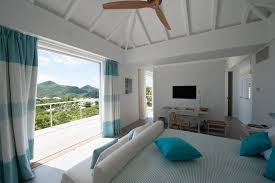 caribbean themed bedroom bedroom tropical with ventilateur de plafond blade  ceiling fans