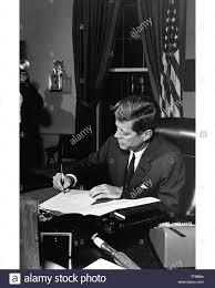john f kennedy oval office. President John F. Kennedy Signs Legislation In The Oval Office At White House. F
