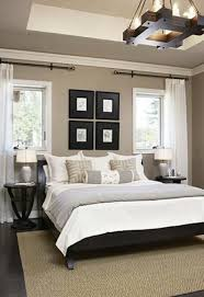 The Cliffs Cottage at Furman | Black headboard, Neutral walls and White  bedding