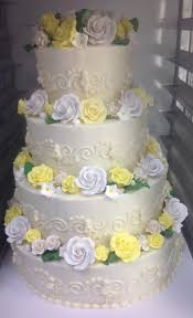 Tiered Traditional Wedding Cake With Sugar And Fondant Flowers