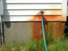 remove rust from siding