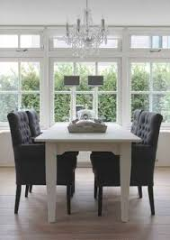 deep gray upholstered and tufted dining room chairs for fortable seating look great with a