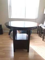 pleasanton ca dining table which turns to oval shape and round shape and has storage with three chairs