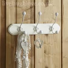 three hooks on wooden ivory plaque three hooks on wooden ivory plaque