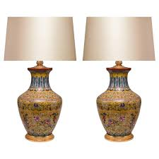 pair of imperial yellow ground famille rose porcelain lamps
