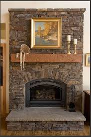 rustic stone fireplace with brown mantel shelf and grey hearth complete with grey firebox