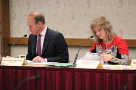 stateimpact na state board of education member vince bertram and state superintendent glenda ritz listen during the a meeting in 2015