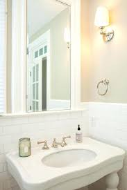 how to paint over bathroom wall tile lovely bathroom features cafe paint on top half of walls and subway tiled on bottom half of walls framing framed mirror