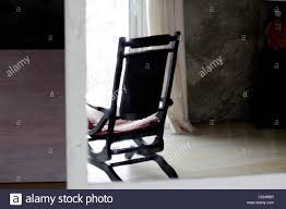 rocking chair silhouette.  Silhouette Comfort Rocking Chair In Front Of Large Window Looking Out Over A Snowed  Under Landscape  Intended Rocking Chair Silhouette