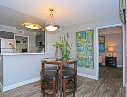 dining area adjacent to the modern kitchen in a model home at solis at flamingo in