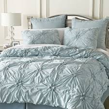 calestial blue ruched duvet cover with table lamp
