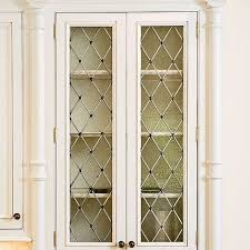 kitchen cabinets glass doors design style: kitchen cabinets with diamond shaped leaded seeded glass front doors for a furniture style china cabinet look interior designer denyse rinfret builder