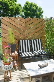 Free standing outdoor privacy screens Timber Chevron Pattern Wall The Selfsufficient Living 17 Diy Privacy Screen Projects For Your Patio Or Backyard The Self