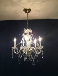 vintage crystal chandelier five glass arms hollywood regency mid century hanging chandelier glam look with lots of crystals crystal core