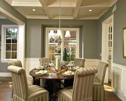 source swag chandelier over dining table ceiling