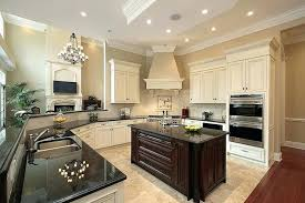 white kitchen cabinets with dark countertops transitional off white kitchen with dark island in home within