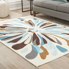 ebern designs saira cream blue brown indoor outdoor area rug within and decorations 0