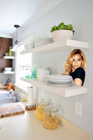 white ikea lack floating shelves in our kitchen with beyonce photoped on one of them