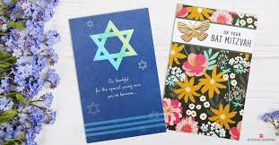bar and bat mitzvah cards and purple flowers