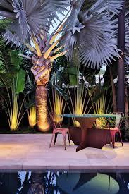 magnificent fake palm treesin patio