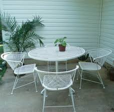round metal patio table and chairs designs