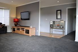 Soft grey paintwork complimenting the smokey grey carpet for a harmonious living  room. www.