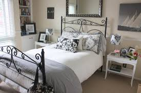 guest bedroom. a small and yet elegant guest room with books creature comforts bedroom