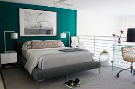 Master Bedroom With Grey Platform Bed And Coverlet Also Nighstand With  Table Lamp And Turquoise Accent