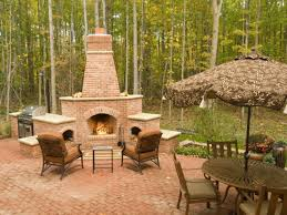 chiminea outdoor bricks fireplace with cozy chair and pavers flooring for patio decoration ideas