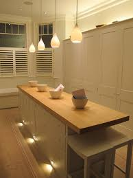 lighting in the house. low level lights in window vertical face of seat or lighting log stack the house l