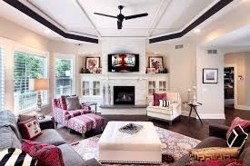 stack stone fireplace living room transitional with built in white cabinets black round side table