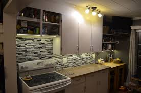 do it yourself under cabinet lighting. this instructable will give you the building blocks to install your under cabinet led tape without soldering any wires. do it yourself lighting h