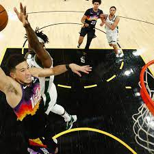 Devin Booker and Phoenix Suns torch Bucks to go halfway home in NBA finals  | NBA finals