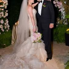 It's an ivory shade with a fishtail skirt and its got these empowered shoulders. Hilary Duff And Mike Comrie S Wedding Arabia Weddings