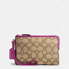 COACH f54627 CORNER ZIP WRISTLET IN OUTLINE SIGNATURE IMITATION GOLD KHAKI  FUCHSIA