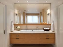 awesome bathroom vanity ideas with wall mirror and wall lamps plus floating wood cabinets also towel hanger and recessed ceiling lighting
