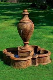 jubilee vase garden fountain w four spill spouts set on a quatrefoil patterned pool