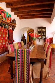 I hung these woven fabrics on the backs of the chairs to add color to what  are otherwise boring beige chairs! We love Mexican style.