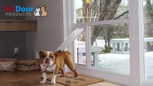 sliding glass door with dog door built