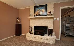 Anchored By A Floortoceiling Austin Stone Fireplace The Austin Stone Fireplace