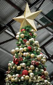 Decorating Christmas Tree With Balls Artificial Christmas Tree With Red And Gold Balls And Star Stock 99