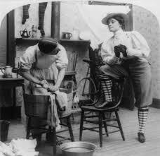 new w a satirical photo from 1901 the caption new w wash day shown is a w wearing knickerbockers and knee socks traditional male attire and