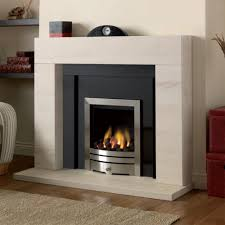 lagos limestone fireplace with a polished black granite panel and slips shown with an inset gas