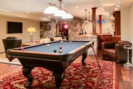 area rugs for man cave basement traditional with red patterned rug industrial pendant light red patterned