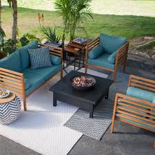 wood patio furniture with teal cushions