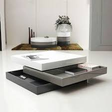 modern furniture coffee tables. from white to dark gray a first glance this three toned table makes stunning statement these highgloss stacked trays fan out not only for dramatic modern furniture coffee tables